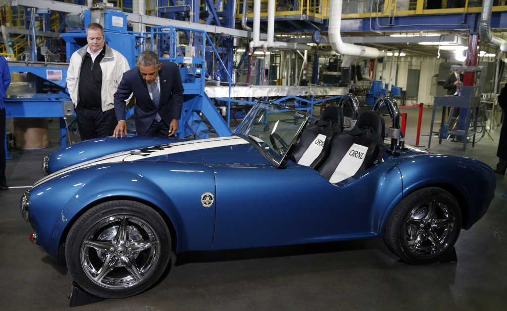 US President Barack Obama takes a look at a 3D printed Shelby Cobra car